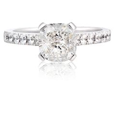 Razzle Dazzle  A stunning cushion cut diamond ring. The cushion cut is set in a simple yet modern platinum four claw setting, with brilliant cut diamonds set into the band.    Carat : 1.23 ct   Colour : G  Clarity : VVS2  http://www.waldemarjewellers.com.au
