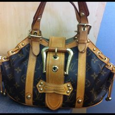 Authentic Pre Loved Louis Vuitton Theda Will Consider all reasonable offers!!!!  limited edition was released in 2004, and sold out within weeks. A truly stunning piece made out the traditional monogram canvas with cowhide trim and straps and golden tone hardware. The hardware includes the attractive signature front buckle, beautiful studs, rings and straps buckles. Its interior is fully lined in tan alcantra and offers a wide compartment and one convenient patch pocket! No Trades on this…