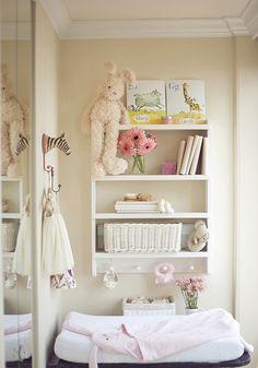 Gorgeous baby nursery. Love the idea of pegs with toys to keep baby occupied while changing diaper.