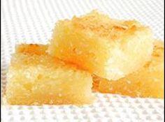 Receita de Bolo de Aipim - 1 kg de aipim (mandioca), 3 xícaras (chá) de açúcar, 100 g de manteiga, 200 ml de leite de coco, 1 pacote de coco ralado, 1 pitada de sal, 1 xícara (chá) de leite
