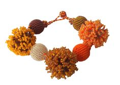 Fluffy bracelet - Oranges - made by the crafters of Woza Moya. www.hillaids.org.za