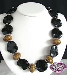 Do you or someone you know like wearing statement necklaces? Then this one-of-a-kind necklace with unique ceramic beads is for you. $58- Click:http://earthandmoondesign.com