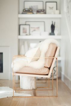 Gold frame chairs with leather seats by Nicole Davis
