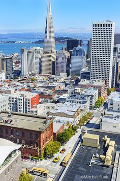 High Angle View Of Cable Cars With San Francisco Skyline In The Background. www.mitchellfunk.com