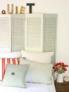 Two-tone shutters in off-white and pale blue set the stage for this sweet cottage-style room. Design by Layla Palmer.