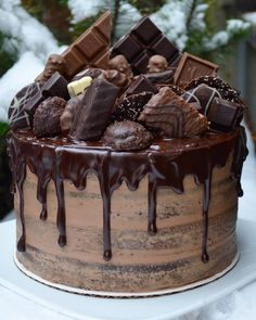 Dark Chocolate drip cake with a marzipan filling, topped with an explosion of Belgian chocolates and Ritter Sport. Special birthday cake… A chocolate Chocolate Strawberry Cake, Dark Chocolate Cakes, Strawberry Cakes, Best Chocolate, Belgian Chocolate, Chocolate Ganache Cake, Nutella Cake, Chocolate Cake Decorated, Choc Drip Cake
