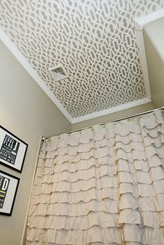 Crown molding plus stencil on ceiling for bathroom.