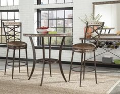 Simple Styling And Elegant Detailing Are The Hallmarks Of The Emmons Bar Height Bistro Dining Collection. Featuring A Unique Washed Gray Finish And Stud Detailing, The Wood, Rectangular Emmons Bistro Table Is Accented By Its Elongated, Curving Legs. Round Pub Table, Round Dining Set, Solid Wood Dining Set, Kitchen Dining Sets, Pub Table Sets, Dining Room Sets, Pub Tables, Round Bar, Furniture Dining Table
