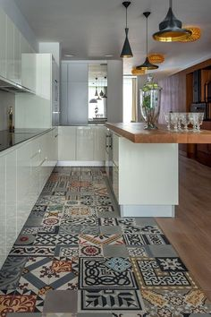 Narrow kitchen with island and breakfast nook in one and beautiful patterned tile floor