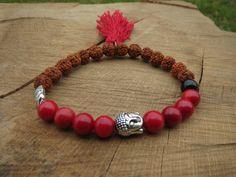 Check out this item in my Etsy shop https://www.etsy.com/uk/listing/205203545/rudraksha-bracelet-red-coral-tassel