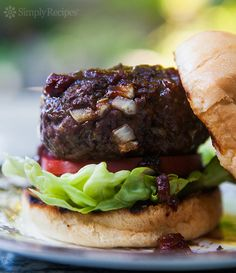 Bison Burger ~ American buffalo (bison) burger made with ground buffalo meat and seasoned with sage, topped with smoky barbecue sauce. ~ SimplyRecipes.com