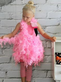 DIY Network has instructions on how to make an easy feathered flamingo costume using some inexpensive boas and ribbon. (How To Make A Tutu Step By Step) Halloween Costumes Pictures, Cute Costumes, Halloween Kids, Halloween Stuff, Halloween Makeup, Halloween Party, Fancy Dress Costumes Kids, Zombie Costumes, Halloween Couples