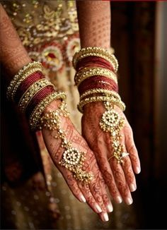 Stunning bangles and mehendi for the bride!