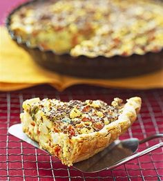 A quiche recipe that has all the fixings of a traditional farmer's breakfast--eggs, ham, cheese, and hash brown potatoes--all baked in a pie.