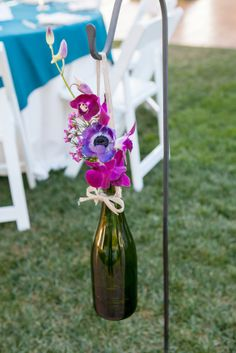 wine bottles on shepherd hooks. loved this special touch to our wine themed wedding. Thank you Soiree Design and Events!