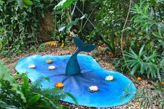 "Mermaid cove - just use blue fabric or paper cut into a ""pond"" shape and put a cardboard mermaid tale coming out with fake flowers"