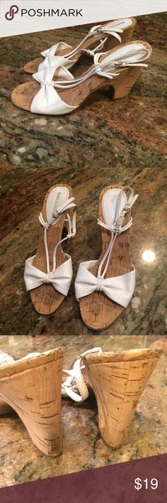 """ENZO ANGIOLINI White leather Sandals cork heel White leather upper sandals with a cork heel and trim. Size 6.5. Adjustable ankle strap. Some wear on cork and marks on bottom soles. Heel height 3.5"""". Enzo Angiolini Shoes Sandals"""
