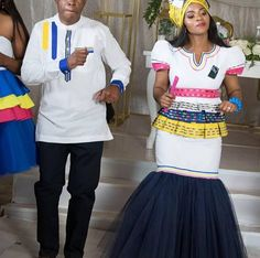 Bride in modern Pedi top with mermaid skirt and Doek. Groom in Pedi inspired shirt. Pedi Traditional Attire, Sepedi Traditional Dresses, African Traditional Wear, Traditional Wedding Attire, African Beauty, African Fashion, Beaded Cape, Mermaid Skirt, Cape Dress