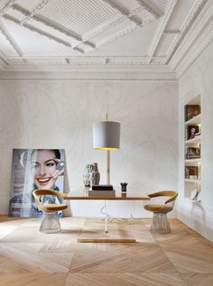 Very cool space ~ ceiling, scale and Knoll chairs