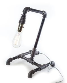 DIY Industrial Lamp is made from pipe, pipe fittings and a simple lamp kit. You can make this lamp yourself to add a bit of an industrial chic look to your desk or table. We have the tutorial on The Home Depot Blog. #industriallamps