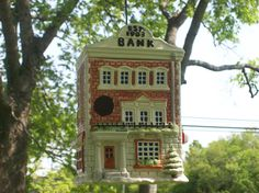 Repurpose a cookie jar or collectible house into a birdhouse