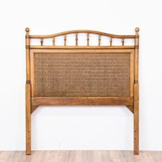"""This tropical twin sized headboard is featured in a solid wood with a carved bamboo trim. This headboard is in great condition with a curved top and woven wicker panel. Beach chic bed perfect for a kid's room!    Dimensions: 39""""L x 2""""D x 44""""H   #tropical #beds #headboard #sandiegovintage #vintagefurniture"""