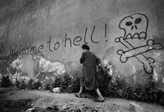 "Welcome to hell - a woman hurries past graffiti in the area known as ""Sniper Alley"" in Sarajevo's main thoroughfare, during the siege in 1992.      [Credit : Tom Stoddart/Getty Images]    (via freetobefreee)"
