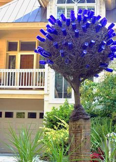 Today On Springwolf Reflections: Blue Bottle Trees - They're not just Appalachian Folklore. They're history is long, interesting and you can learn to make your own tree to ward off evil from your home, garden or patio. Wine Bottle Art, Blue Bottle, Wine Bottle Crafts, Wine Bottle Trees, Garden Crafts, Garden Projects, Garden Art, Tree Garden, Garden Junk