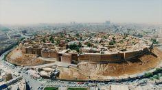 High angle drone shots establishing cities and markets.