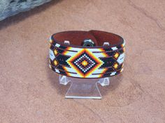 This American Indian beaded Leather bracelet with the classic Cherokee pattern is made with the blends of the fire colors of the Southwest along with a splash of dark copper. The bracelet is a leather