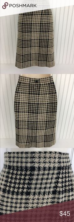 "ESCADA Wool Houndstooth Beige and Black Skirt Be on trend this fall with this Escada Wool blend houndstooth pattern skirt.  Beige and black  Completely lined hidden zipper in the back with a button closure 5"" Slit in the back One small stain near the button in the back( see the pictures) , no rips or holes, minimal signs of wear 
