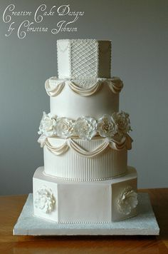 Jessica- Buttercream Wedding Cake by Creative Cake Designs (Christina), via Flickr  May be too fussy.  But I liked it