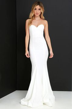 """Amp up your """"curve"""" appeal at that upcoming gala with the Sorella Ivory Strapless Maxi Dress! A strapless sweetheart bodice has a stunning fitted shape thanks to a hidden V-bar at front, boning and elastic at back, and princess seams. The ivory woven material makes its way down into the maxi skirt finished with flaring godets, and hidden bottom band for added structure. Hidden back zipper with clasp."""