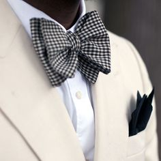 Cream blazer and gingham bow tie.