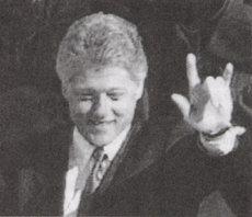 Clinton with Illuminati hand sign