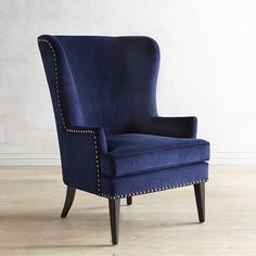 A graceful wing chair in search of a cozy corner, Asher is all about classic lines, mid-century modern legs and rich velvet upholstery with nailhead trim. It's ready to hold draped throws and stacked pillows. Why not invite a small table to hold tea and books?