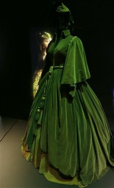 """The green velvet """"curtain dress"""" worn by British actress Vivien Leigh as Scarlett O'Hara in the iconic 1939 movie """"Gone with the Wind"""" on display at the Hollywood Costume exhibition at the Victoria and Albert Museum in London Wednesday, Oct. Theatre Costumes, Movie Costumes, Vintage Dresses, Vintage Outfits, Vintage Fashion, Narnia, Star Costume, Hollywood Costume, Golden Age Of Hollywood"""