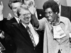 Rep. Barbara Jordan, D-Texas, joins Carter at the podium after his acceptance speech at the Democratic National Convention in New York City in 1976.  AP
