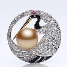 Mikimoto. Pearl and diamonds brooch.                                                                                                                                                      More