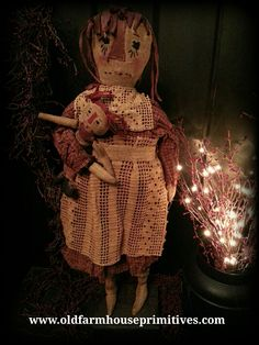 #RP12 Primitive Standing Raggedy Ann Holding Doll (Made In USA)