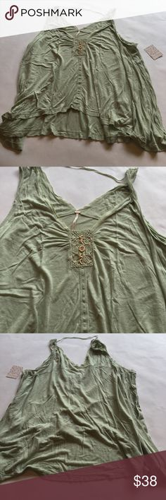 Free People Swing Tank in Mint Brand new, Free People swing Tank. Mint green crochet, wood bead and leather string detail on front. One shoulder has twist for an asymmetrical look. Free People Tops