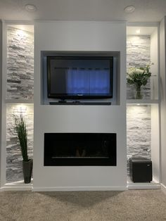 We built this in our living room. Feature Wall Living Room, Living Room Tv, Living Room With Fireplace, Living Room Kitchen, Fireplace Tv Wall, Fireplace Design, Finished Basement Bars, Recessed Electric Fireplace, Glass Extension