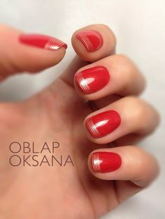 Variation on a French mani with fine gold stripes on red.