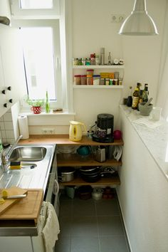 What a great tiny kitchen with really nice countertops and shelving