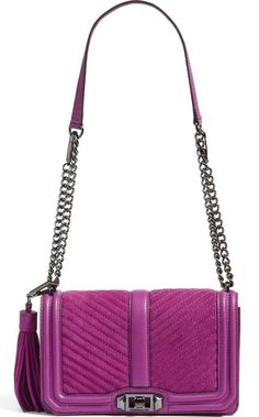 With channel quilting, gunmetal hardware and a lush tassel, Rebecca Minkoff's Love Crossbody in lush purple suede will be the perfect pop of color this season.