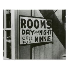 Rooms For Rent, 1939. A sign on a rooming house offers rooms for rent, day and night. Memphis, 1939.