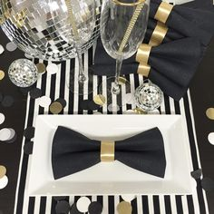 Table decor almost done for tomorrow! DIY: make bow tie napkins for that tuxedo look.