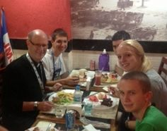 Enjoying Food for Body and Soul in Rio In photo, Bishop James D. Conley enjoys lunch with World Youth Day pilgrims.