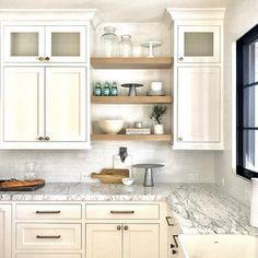 Rift Sawn Shelves. White Farmhouse Kitchen With Rift Sawn Oak Shelves  Between Cabinets. Farmhouse Kitchen With Rift Sawn Oak Shelves Between  Cabinets.