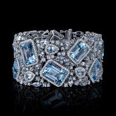 Love this Robert Procop blue topaz and diamond cuff..